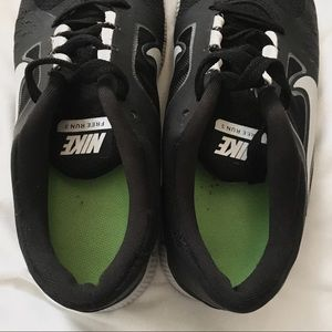 Nike Shoes - Nike Free 5.0 Black and White Running Shoes Size 8